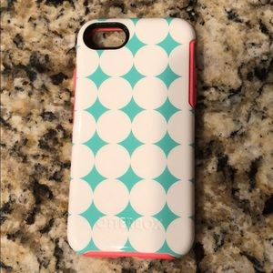 Teal with white dots Otterbox case for iPhone 8.